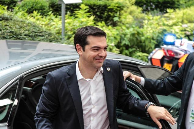 Alexis Tsipras, Greece's prime minister, left, arrives for an emergency Greek summit with European leaders in Brussels, Belgium, on July 7, 2015.